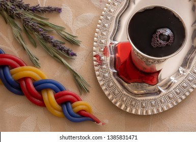 When the Shabbat ends, it is a Jewish custom to light a multi-wick candle, smell fragrant plants and say a blessing on wine.