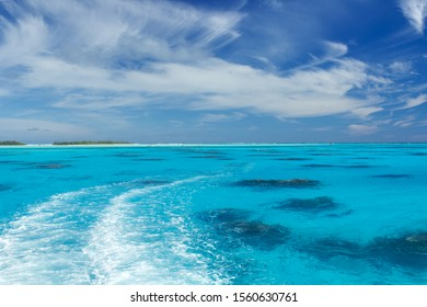 When turquoise sea swirls against blue sky