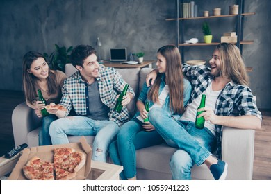 When will the wedding happen? Portrait of cheerful joyful cute talkative handsome attractive friends telling the latest news sitting on a sofa spending time together