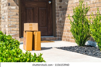 When you arrive and there are Packages delivered to your doorstep , cardboard boxes left on patio doorstep of nice brick home