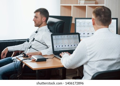 When you understood that is that man do troubles in your business. Suspicious man passes lie detector in the office. Asking questions. Polygraph test.