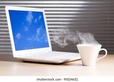 Where do clouds come from? laptop and a cup of coffee