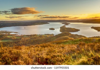"""""""Where the sun shines bright on Loch Lomond...""""    The view from Conic Hill as the sun sets over Loch Lomond."""