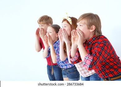 Where are you. Little brisk children holding their hands on their faces and calling friens while standing together isolated on white background.