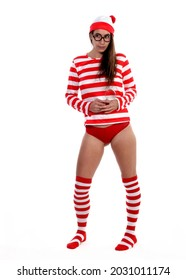 Where's Waldo Style: cute female Caucasian brunette model, long hair, red and white striped shirt and stockings, red underwear, red and white, hat with pom pom, magnifying glass, white backdrop