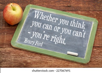 Whether you think you can or you can't - you're right, motivational quote by Henry Ford on a slate blackboard against red barn wood