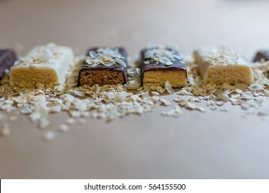 Whey protein bar powder chocolate , corn, coconut, sprinkled oatmeal on the wrapping paper