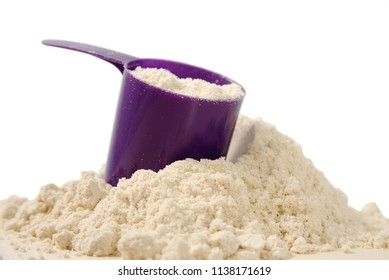 Whey protein food supplement for training and exercise. powdered protein on a light wooden table. powder sports bodybuilding supplement. Close up. texture. Ultra Violet