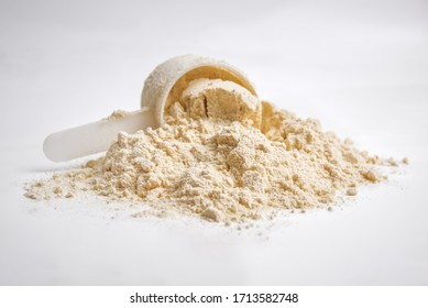 whey protein with scoop isolated on white