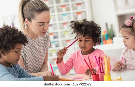 Which color would you like next?  Children in preschool with teacher.