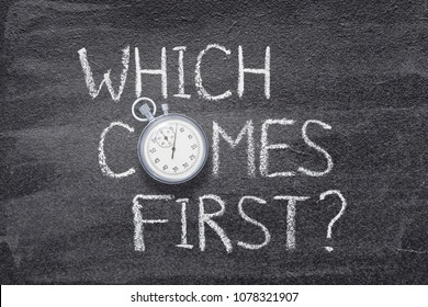 which comes first question handwritten on chalkboard with vintage precise stopwatch used instead of O