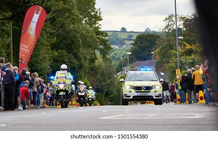WHICKHAM, NEWCASTLE UPON TYNE, ENGLAND, UK - SEPTEMBER 09, 2019: Police motorbikes and cars with flashing blue lights at the first sprint points line of Stage 4 of the Tour of Britain.