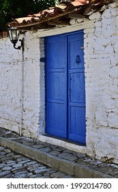 Whie wall and blue door  creating mediterran mood in the medieval fortress of Elbasan, Albania.