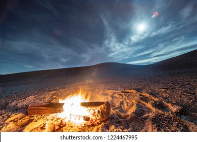 While looking for meteorites at Atacama Desert we made a stop for sleeping in the middle of the amazing Atacama Desert. A camp fire under the full moon light and some stars on the cloud sky. Chile
