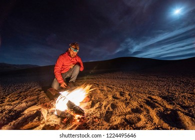 While looking for meteorites at Atacama Desert we made a stop for sleeping in the middle of the amazing Atacama Desert. One man on a camp fire under the full moon light on a starry night. Chile