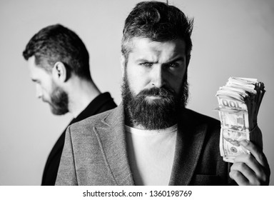 While no one watching. How recognize scam and protect yourself. Dishonest scheme. Scam and fraud concept. Scam and deception. Man bearded fraudster hold cash money while victim stand sad background.