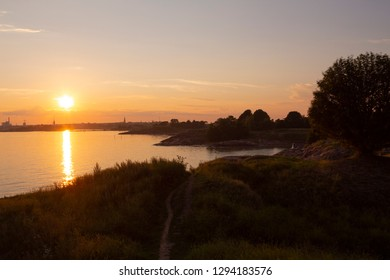 The whimsical rocky coastline of Suomenlinna, and the view of the Gulf of Finland and the sunset on a quiet summer evening in Finland. Beautiful nature of Finland.