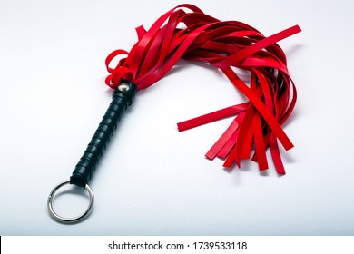 Whip on white background. Accessories for adult sexual games. Toys for BDSM, spanking devices. Spanking and punishment concept. This Whip is specially designed for couples in bedroom.