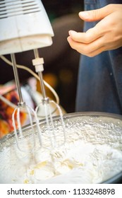 whipped cream cooking process.woman mixing Fresh cream for making whipped cream or desserts and bekery.woman making whipped cream and show process with stand or hand mixer.