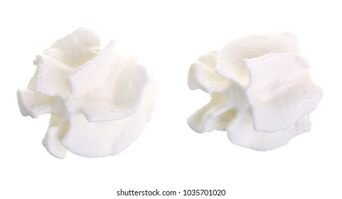 whipped cream or meringue isolated on white background. Top view. Flat lay