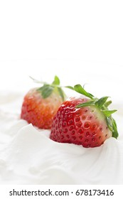 Whipped cream with tasty strawberry