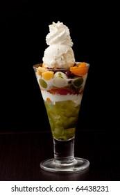 whipped cream vanilla ice cream parfait with orange fruit and red bean