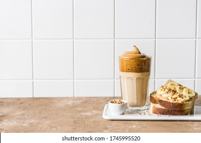 Whipped Instant Dalgona Coffee with Peanut Butter Banana Toast, copy space for your text