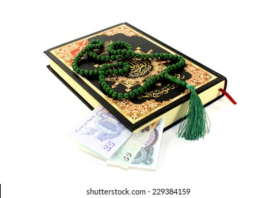 whipped Quran with Egyptian piastre before light background