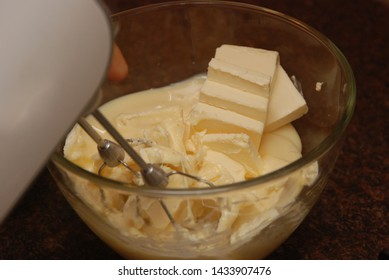 Whipping by a mixer of butter. Making cream.