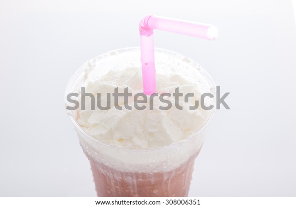 whipping cream topping cocoa milkshake in takeaway cup isolated on white background