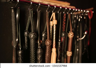 Whips for BDSM on a dark background. Accessory for sexual games.