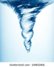 Whirlpool in blue water