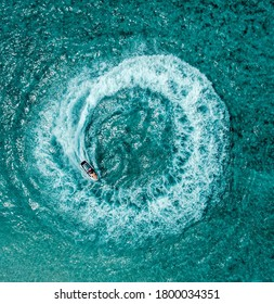 Whirlpool created by a boat in an ocean drone shot