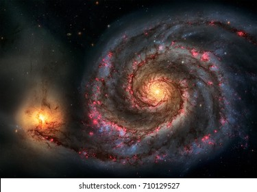 Whirlpool Galaxy and Companion. Winding arms of the spiral galaxy M51 or NGC 5194 appear like a grand spiral staircase sweeping through space. Elements of this image furnished by NASA.
