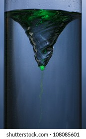 whirlpool with green mist - vortex in a column of water
