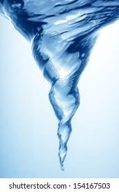 Whirlpool underwater in blue