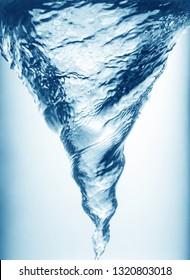 Whirlpool underwater in blue, closeup view