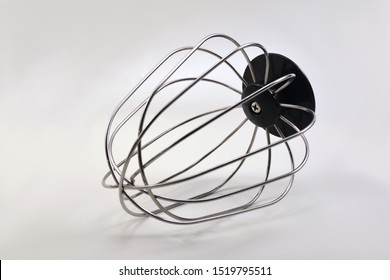 Whisk mixing beater on white background.