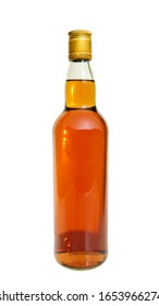 Whiskey alcohol beverage liquor bottle  yellow color closed golden cap isolated on white background. This has clipping path.