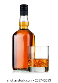 Whiskey bottle and a glass