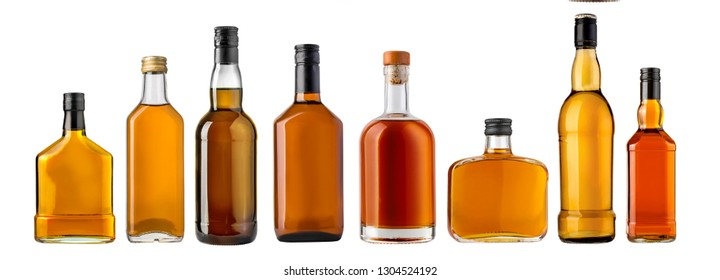 whiskey bottles isolated over a whte background