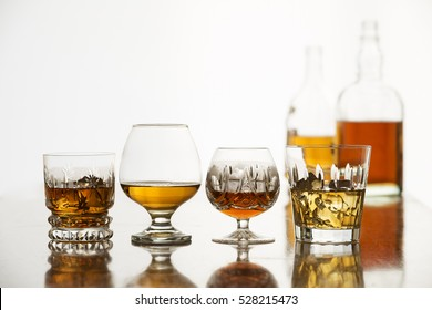 Whiskey, bourbon, cognac and brandy on white