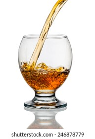 whiskey or brandy being poured into a glass