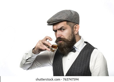 Whiskey, brandy, cognac drink. Brutal bearded man with glass of whiskey, brandy, cognac. Attractive man with a cognac. Old hipster style.