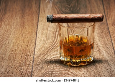Whiskey and Cigar on black background
