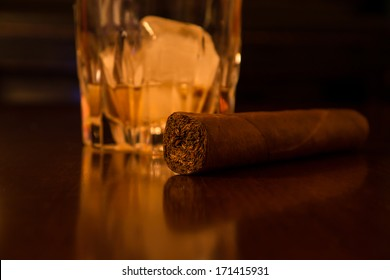 whiskey and cigar on desk
