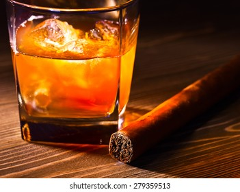 whiskey and  cigar on old wooden table