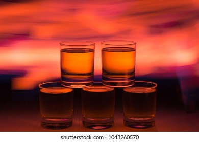 Whiskey in a club atmosphere of flowers of a beautiful red background