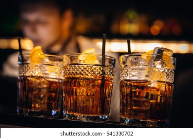 whiskey coctail with beutiful bokeh and serve
