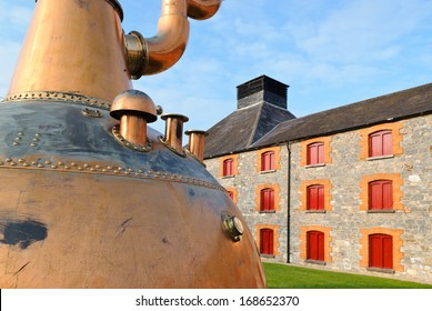Whiskey distillery in Ireland with old copper kettle.